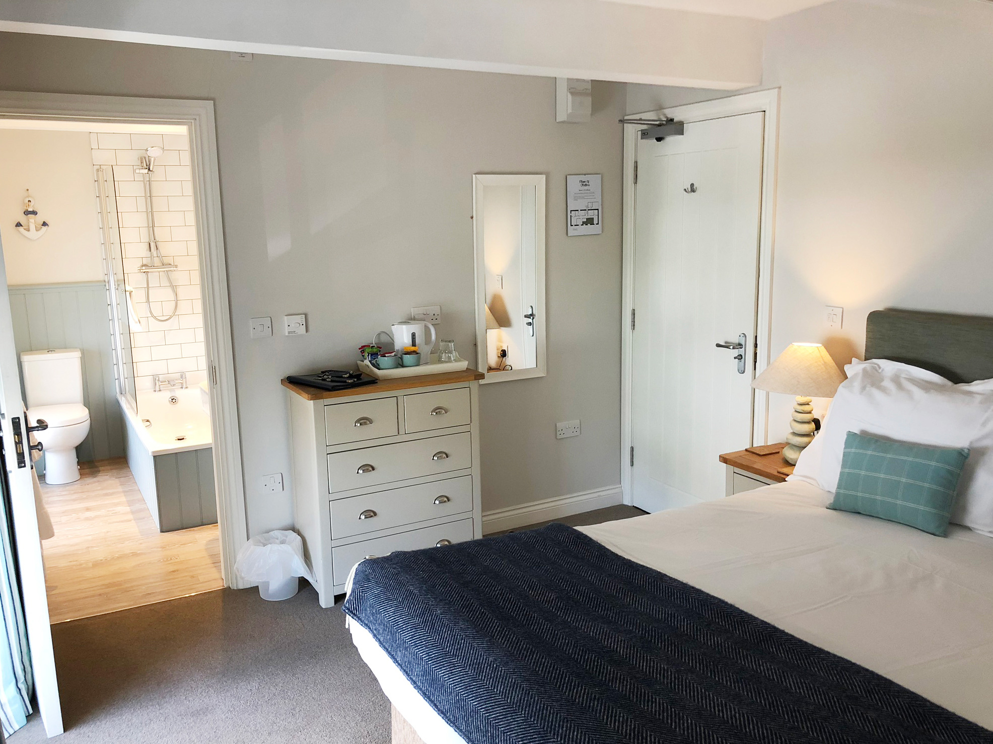 A double en-suite room at The Plume of Feathers