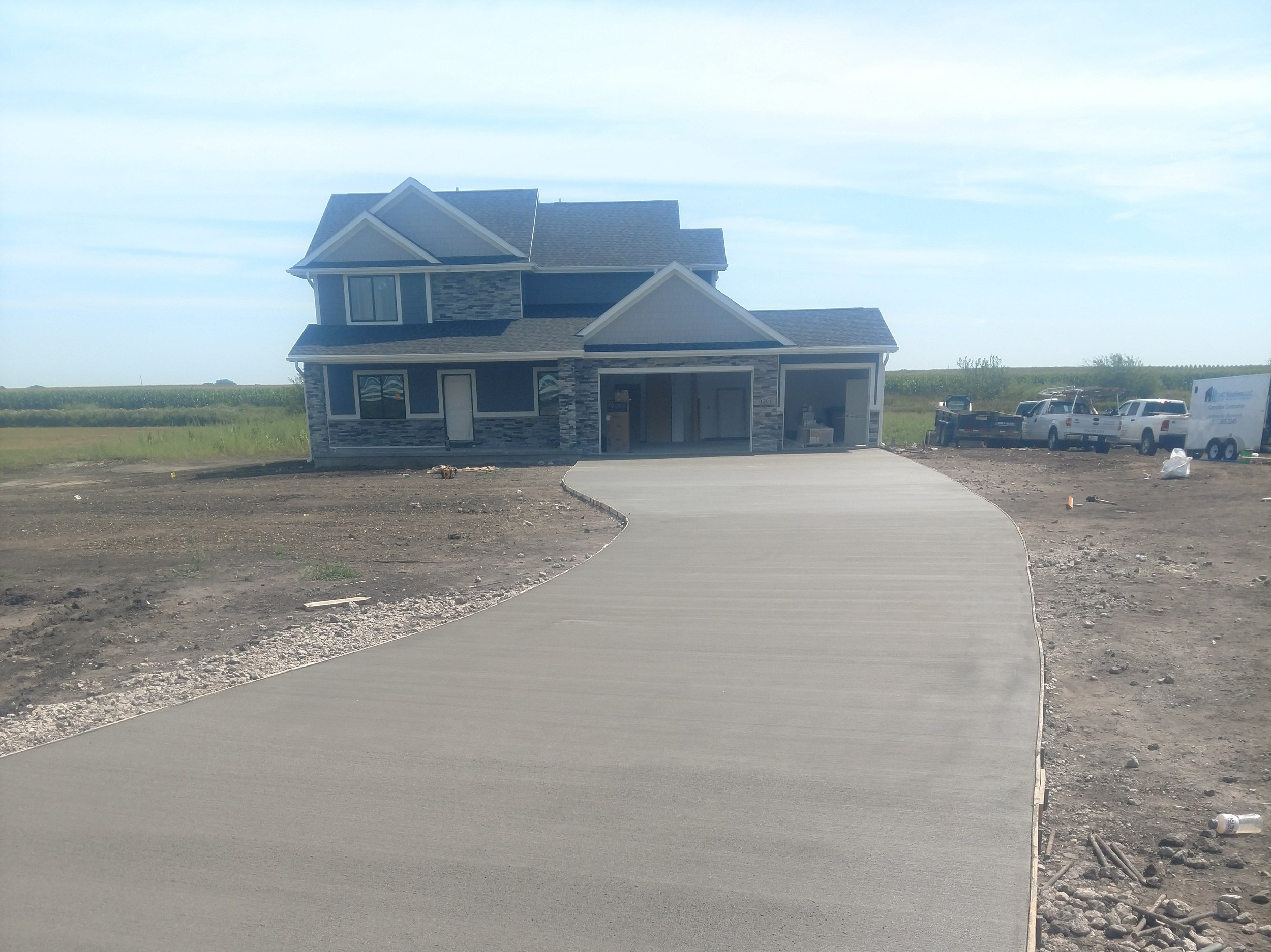 Residential Concrete - Whether your home improvement project requires drainage fixes, concrete crack fills, parking capacity issues, or a new patio installation; our team is trained to design custom solutions that will add value to your home.