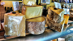 Village Cheese Shops_blocks of cheese.jpg