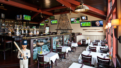 Legends_sports bar with tables and tv screens.jpg