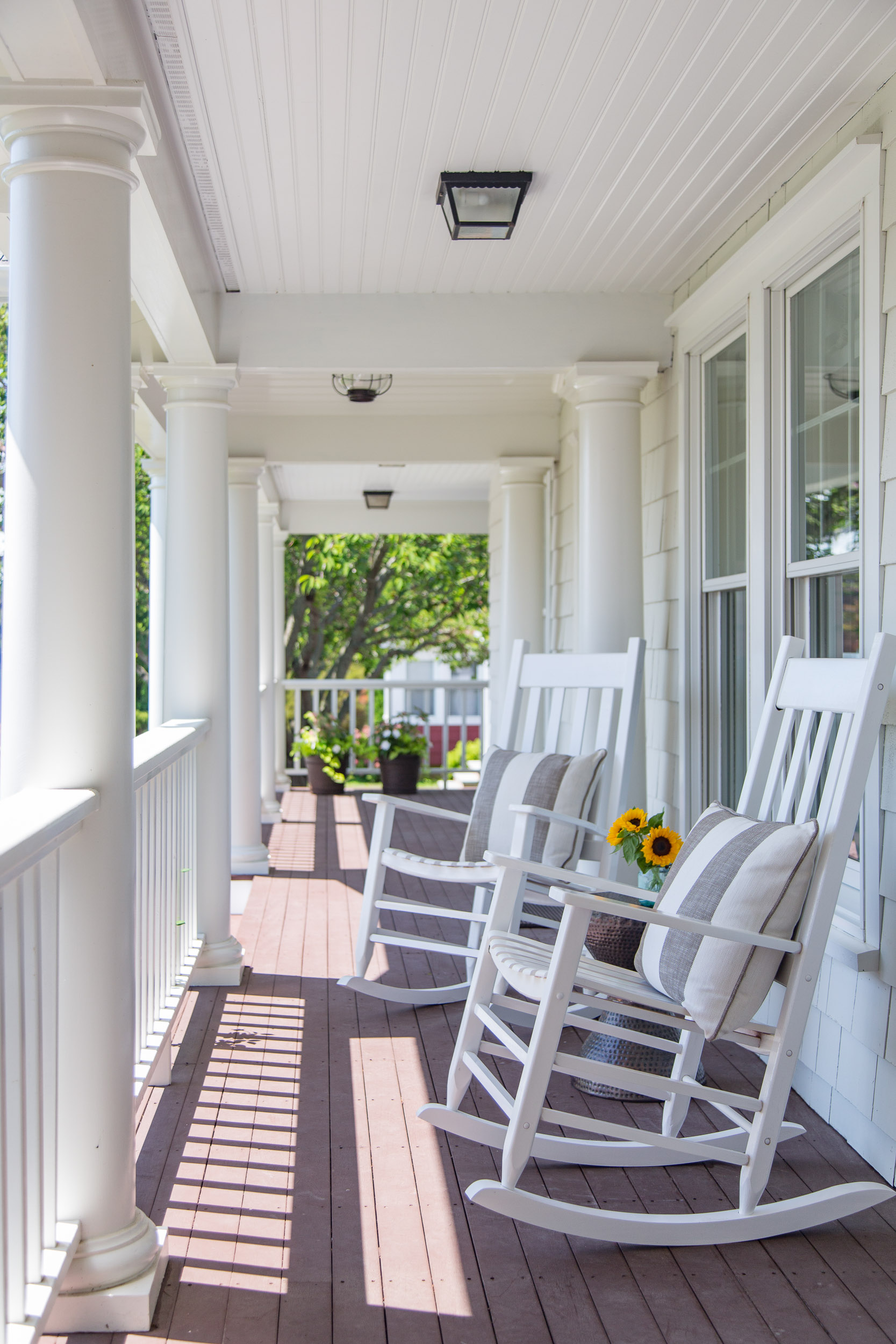 Front porch rocking chairs sunflower striped pillows.jpg