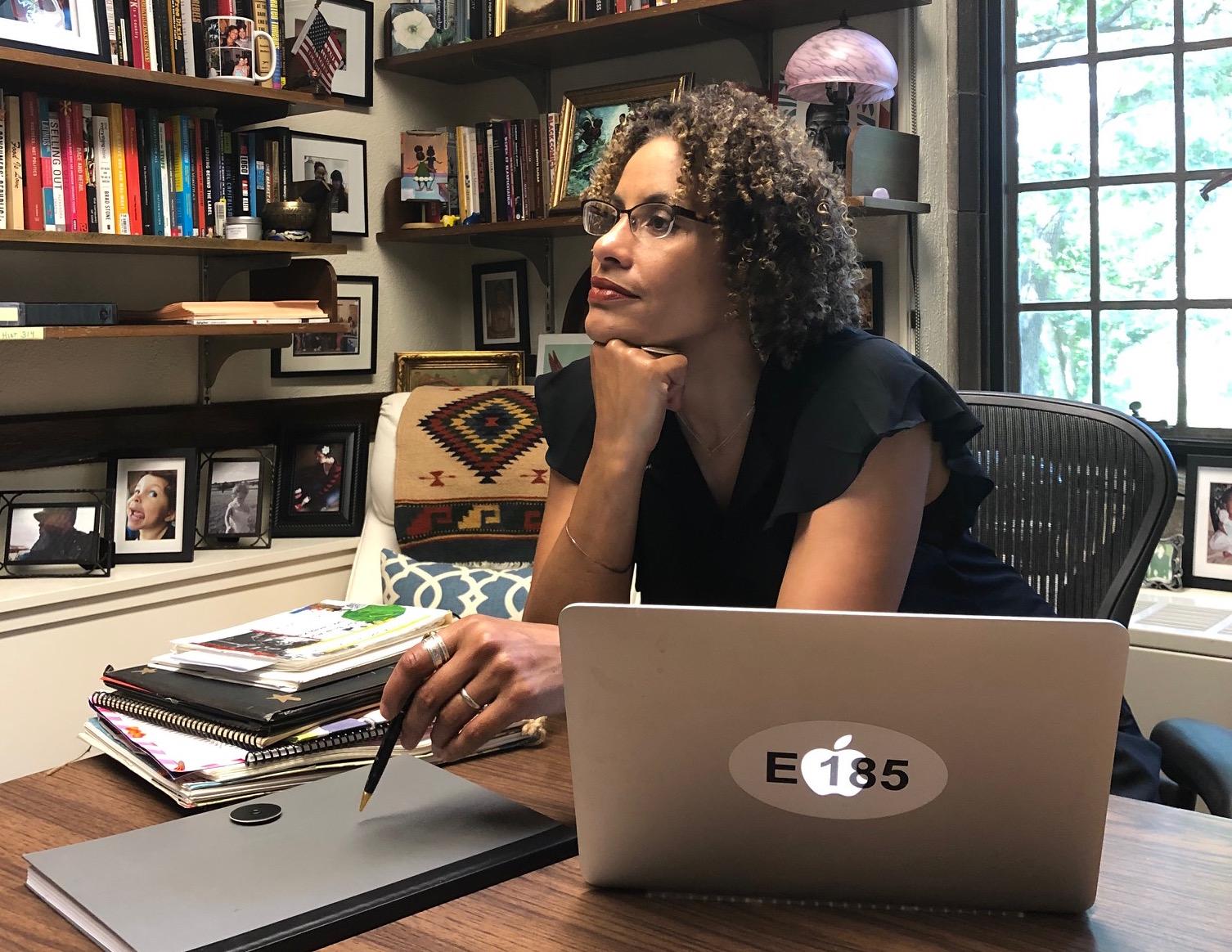 Brenna Wynn Greer at work in her office at  Wellesley College