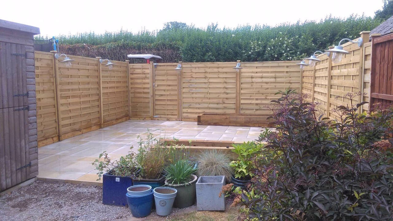 Garden Project - Here we overhauled an overgrown garden and creating a peaceful and tranquil area with new fence panels, gate, slabbing, railway sleepers (with built in LED lights) and lanterns. The owner wanted an area outside suitable for entertaining and for their children to play. They also wanted an area for plants and vegetables.