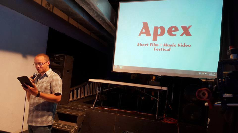 Avai d'Amico speaking at Apex's first event, held at an abandoned gallery in Rochester, MN. (photo submitted by Avai d'Amico)