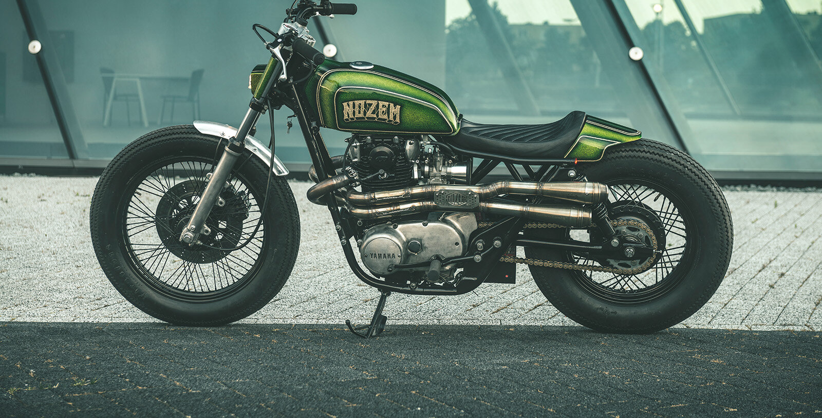 "NOZEM XS650 - ""We thought it was time for something different,"" Nozem co-founder Lorenzo explains. ""We love café racers, but this one is a mix. A bit of tracker, bobber, and chopper.""The design might be quirky, but the levels of finish are superlative. Behind the engine, the frame is completely new—and considerably lower than stock."