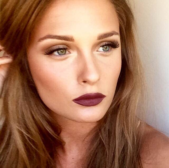 Try an understated neutral eye with fierce brows, dark wispy lashes, and a bold burgandy lip. -