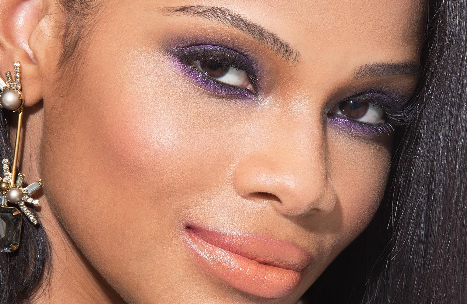 A smokey eye with greys, blues, or deep purples would complete this outfit. So would a nice peach-colored lip! -