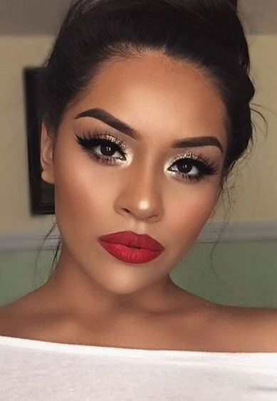 Red lips are sure to brighten this neutral outfit. Combine with neutral eye shadow and dark liner and lashes. Keep your face matte with sharp contours. -