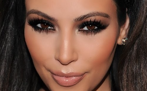 Give your face a tan look and get smokey black with your eyes. Keep everything matte, except for you lips! -