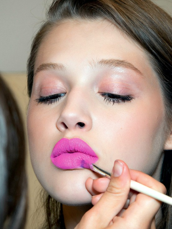 Keep your face light and fresh, sweep a small amount of shimmer and pink over your lids and go big and bold with the lips. -