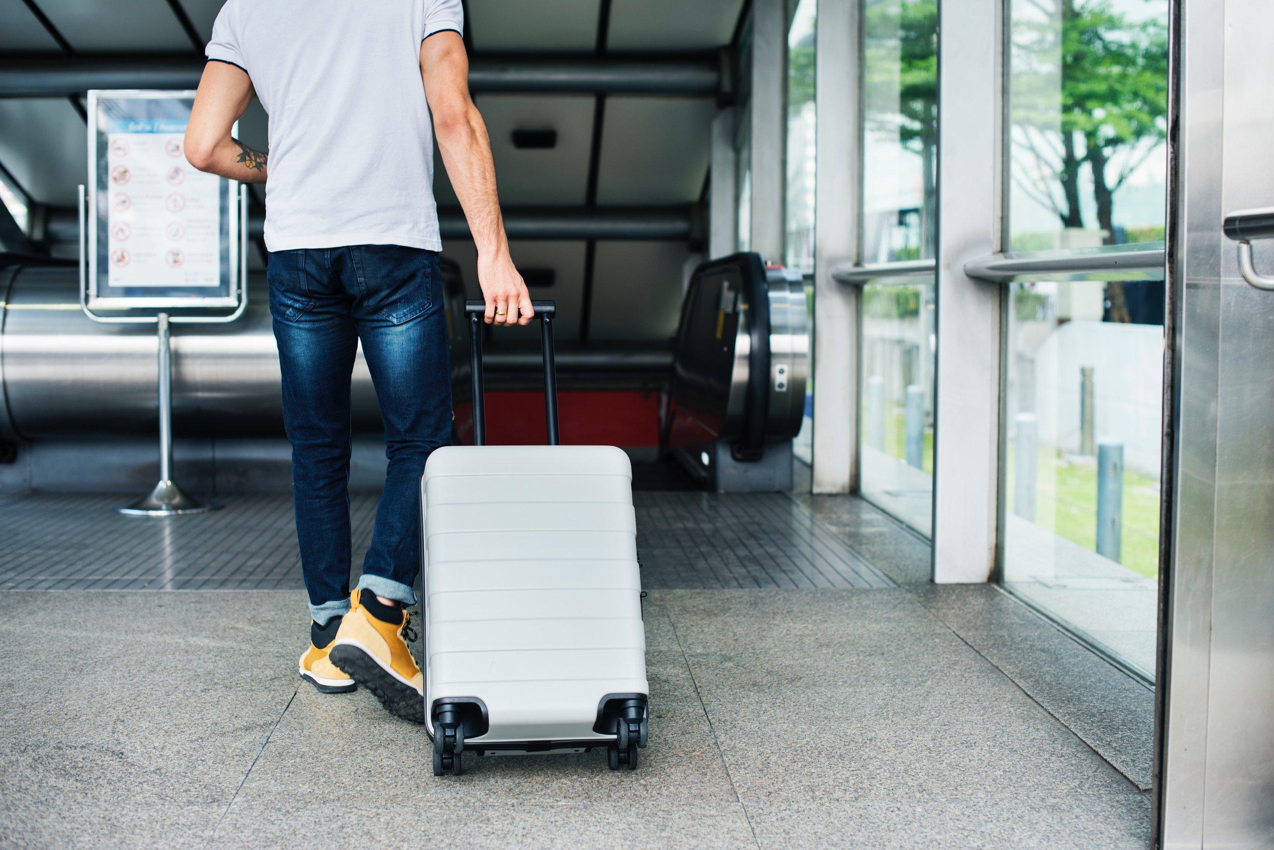 adult-airport-arriving-1457691.jpg