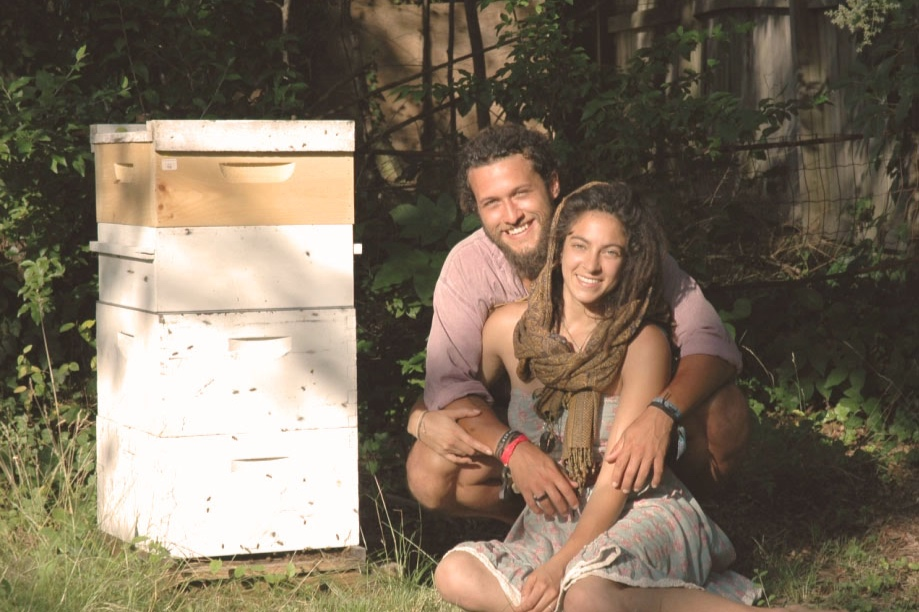 Justin Maness and his wife Juliana with their first hive