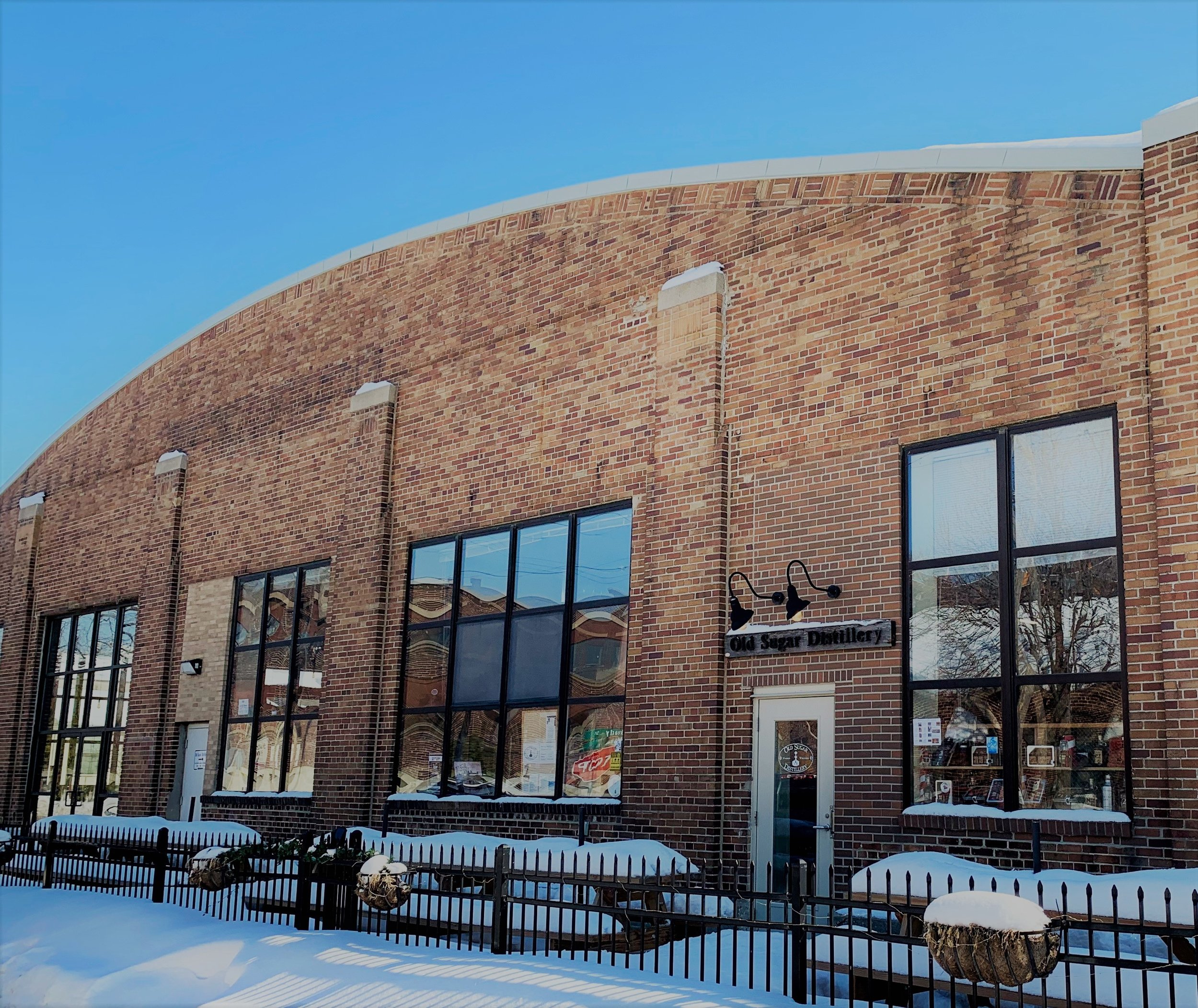 2019 Awards Venue - The name Old Sugar Distillery stems from both Madison's history of beet-sugar production and from the use of sugar as a base for many of the spirits crafted in-house. The distillery and tasting room, founded in 2010 by Nathan Greenawalt, is housed at 931 E. Main in the brown-brick, arched-roof building that for decades served the Madison community as a transportation hub.