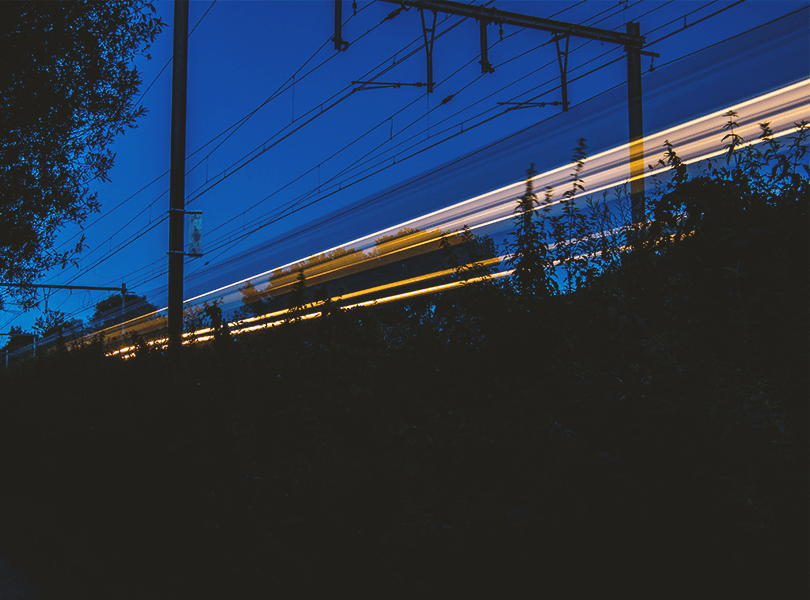 Time-lapse of a train at night