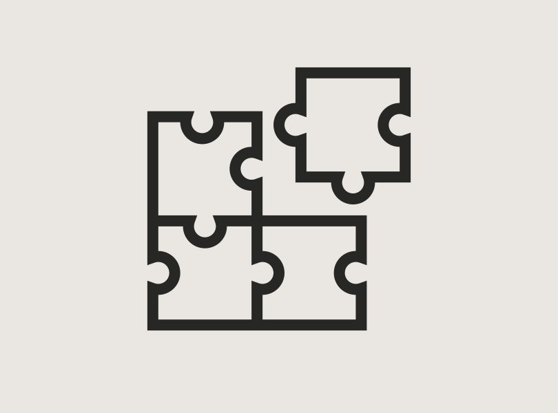 Icon of puzzle pieces fitting together