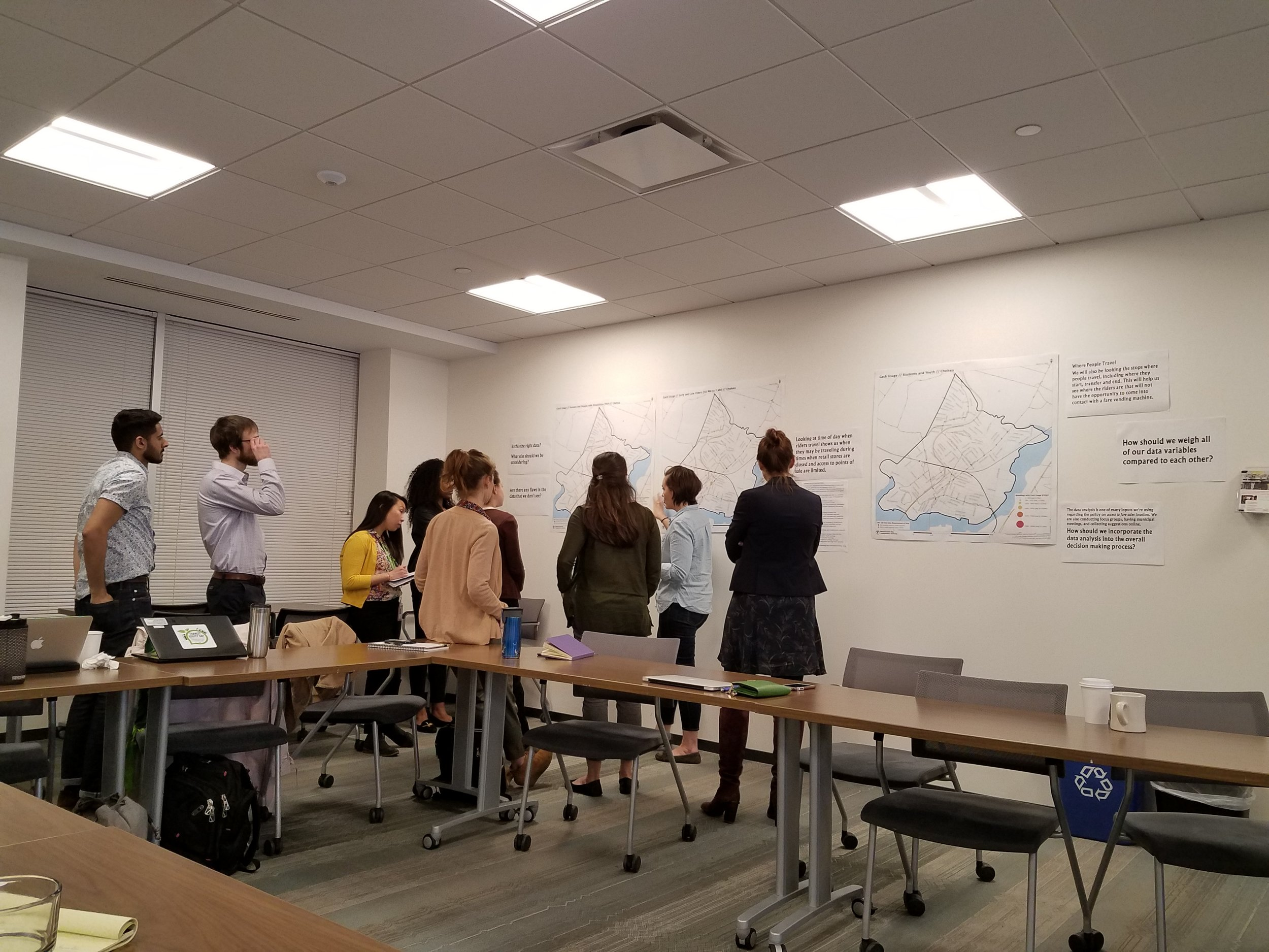 """A group of advocates on the """"Data Gallery Walk"""" ask questions of MBTA representatives and share new ideas for the data analysis process."""