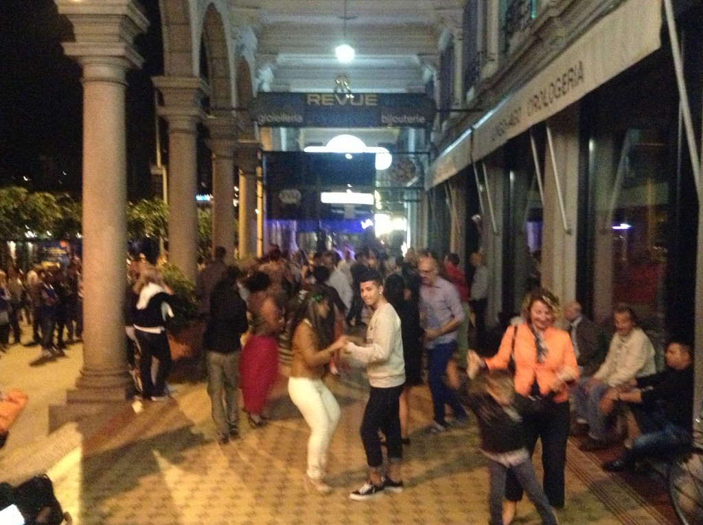 In the arcades and in the streets, large numbers of locals of all ages were dancing around midnight