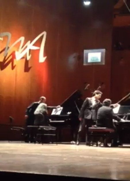 I had to sit unusually far from the pianos–I was not to block the camera views of Argerich. My outfit was specially selected for the occasion, drawing lots of feedback