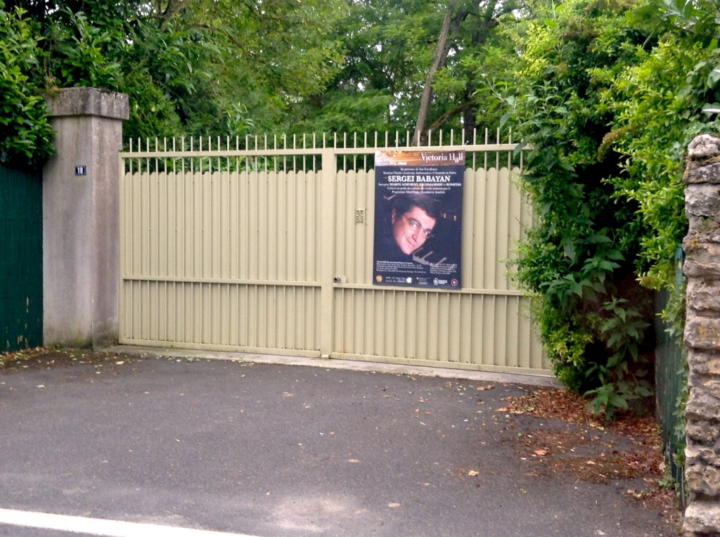 A familiar face on a poster in front of a private residence
