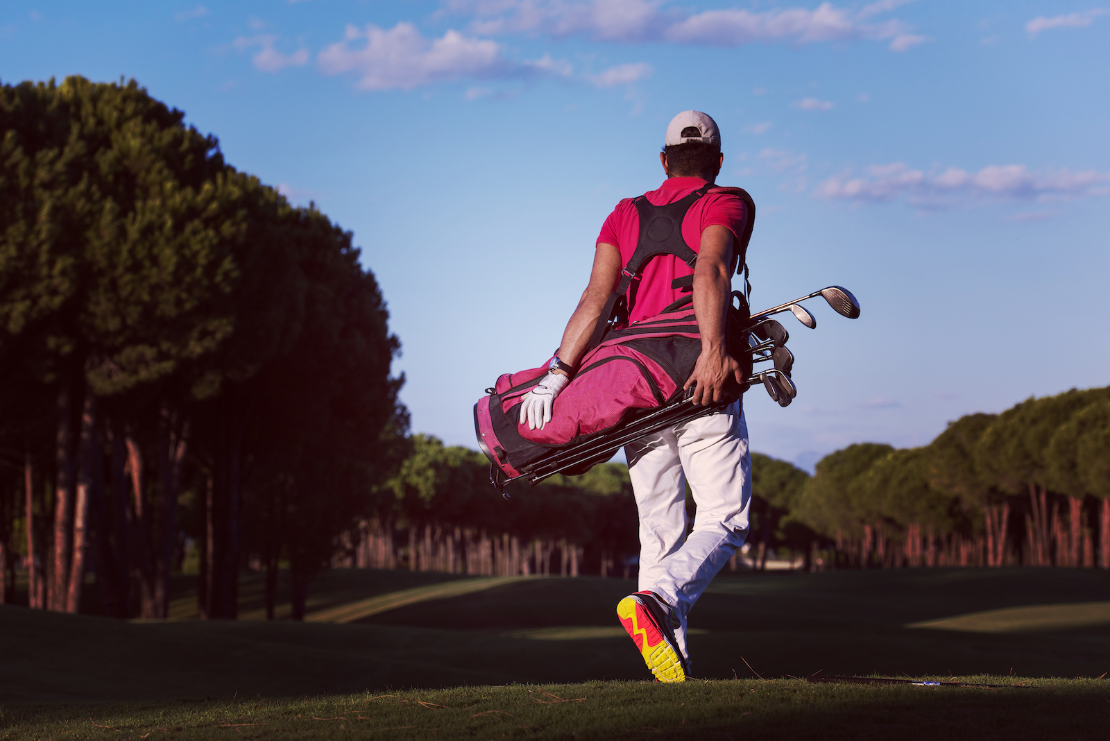 golfer-walking-and-carrying-golf-bag-PJVSCKM.jpg