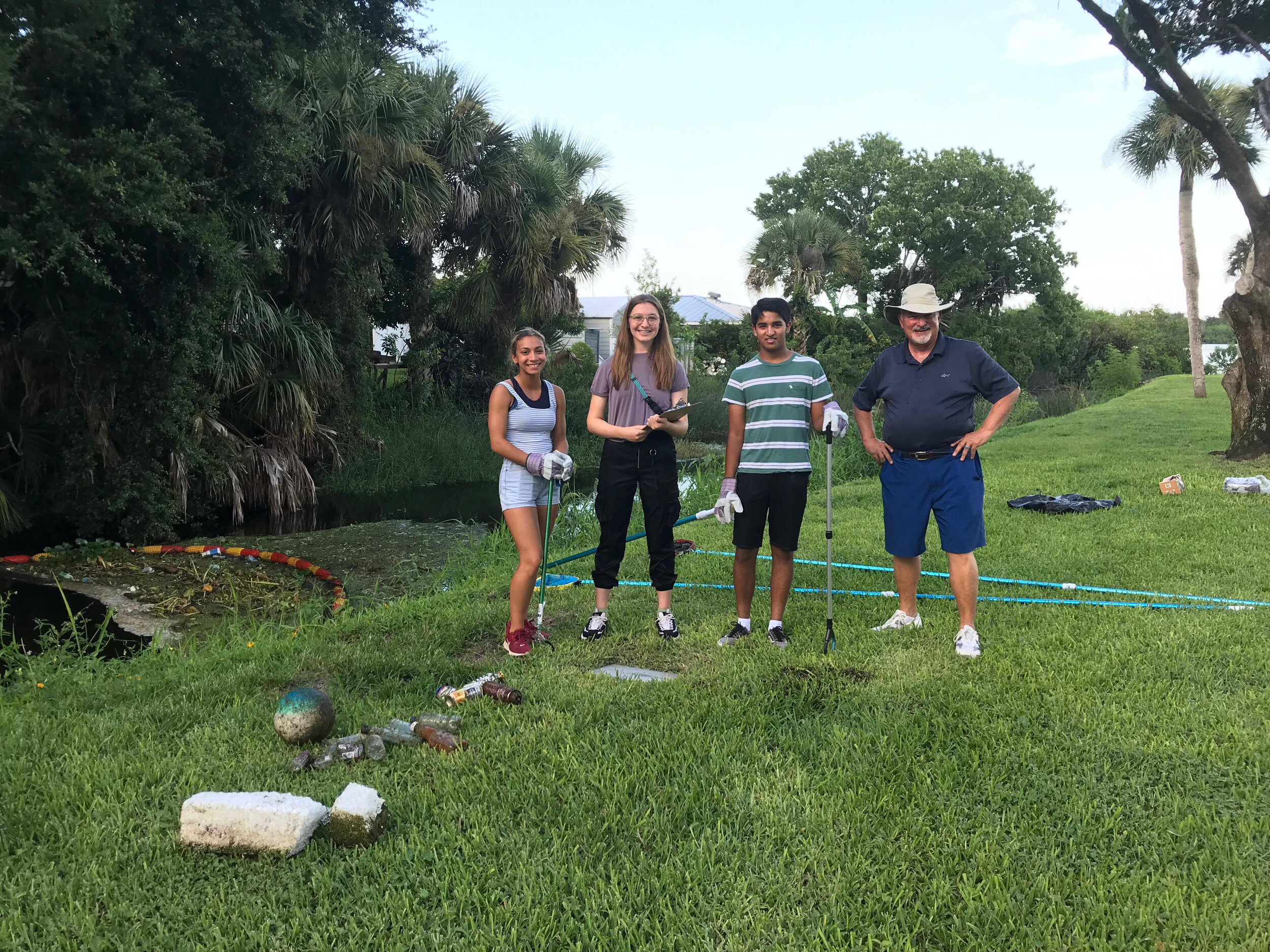 Riverside Young Leaders in Conservation - Victoria Valdez, Raegan Padula and Varune Hoskote track debris collected by the City of Edgewater's WaterGoat at Veterans Park with the assistance of Dr. Art Litowitz, Riverside Conservancy Board Director and Treasurer.