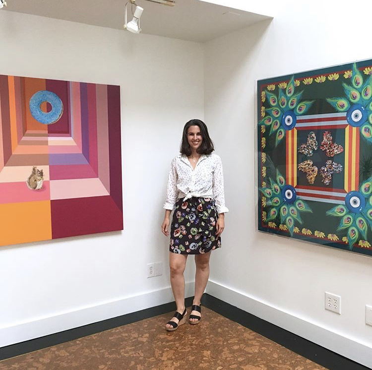 Mione with a few of her gorgeous paintings. Photo c/o  Mione Plant  with  Maestri Gallery