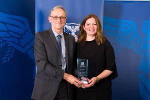 Kerry Elliot accepted the award on behalf of Katherine Henderson