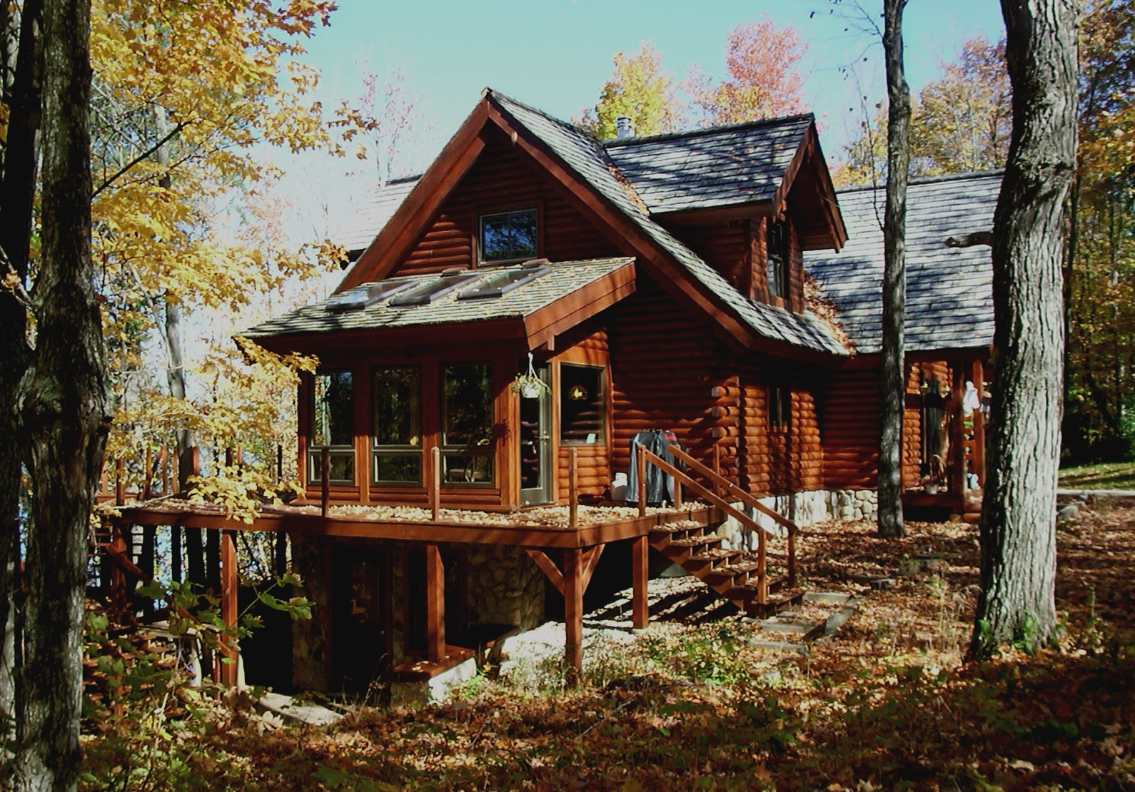 Why a Cedar Log Home - • Custom designing from a basic cabin to an elegant home eliminates architect fees.• Having our own milling operation and construction company insures maximum quality and flexibility.• Because we are a local contractor, it will be easy to assure you of our outstanding reputation.• Massive timber beams used in Loft & Roof system.• Elegance & durability of Northern White Cedar walls.• Tongue & groove cedar paneling and cedar shakes available.• Variety of dormers and covered porches to choose from.• Model home available for your inspection.