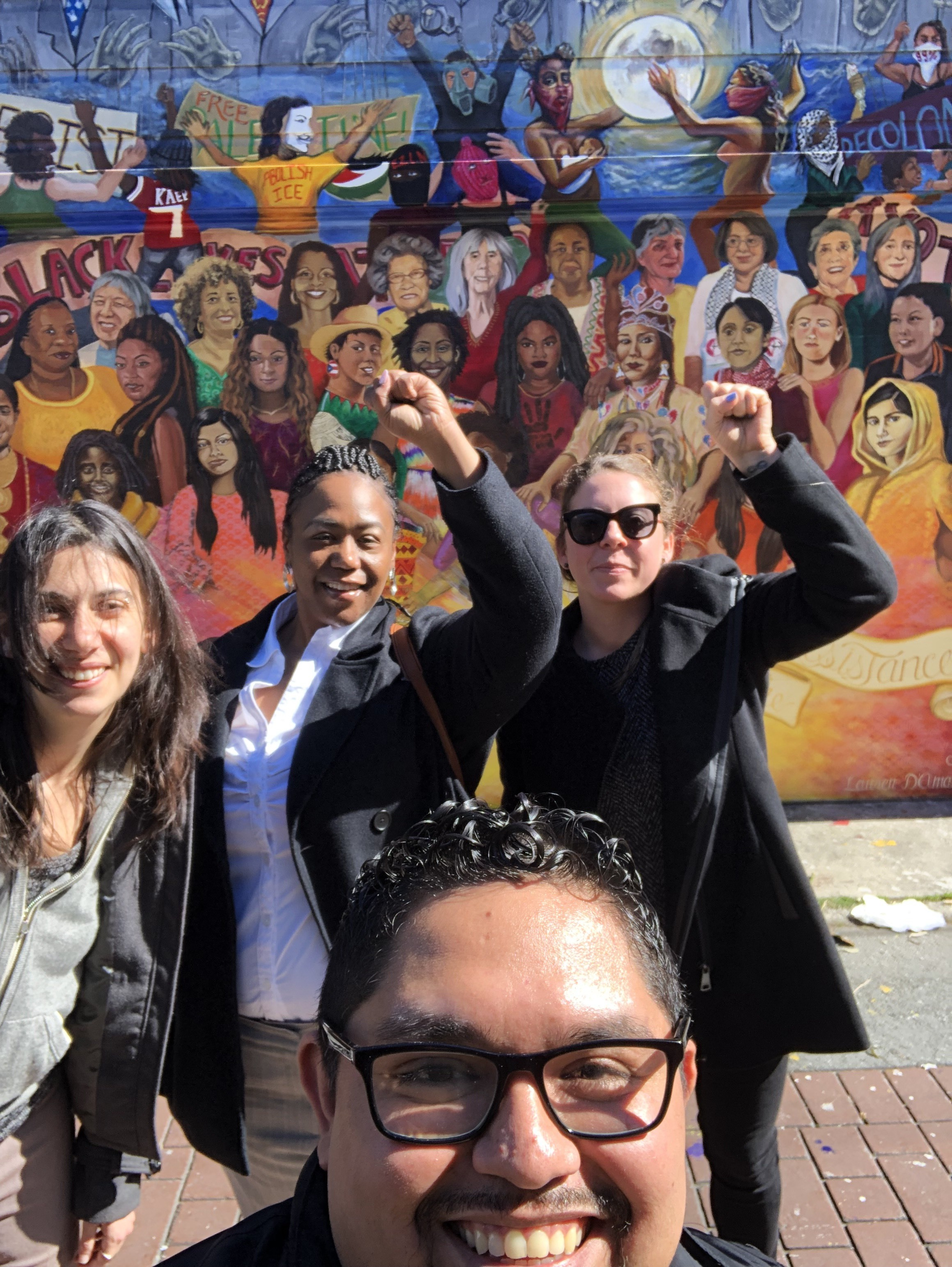 The fabulous team from CSJ out in front of the Women of the Resistance Mural on Balmy Ally.