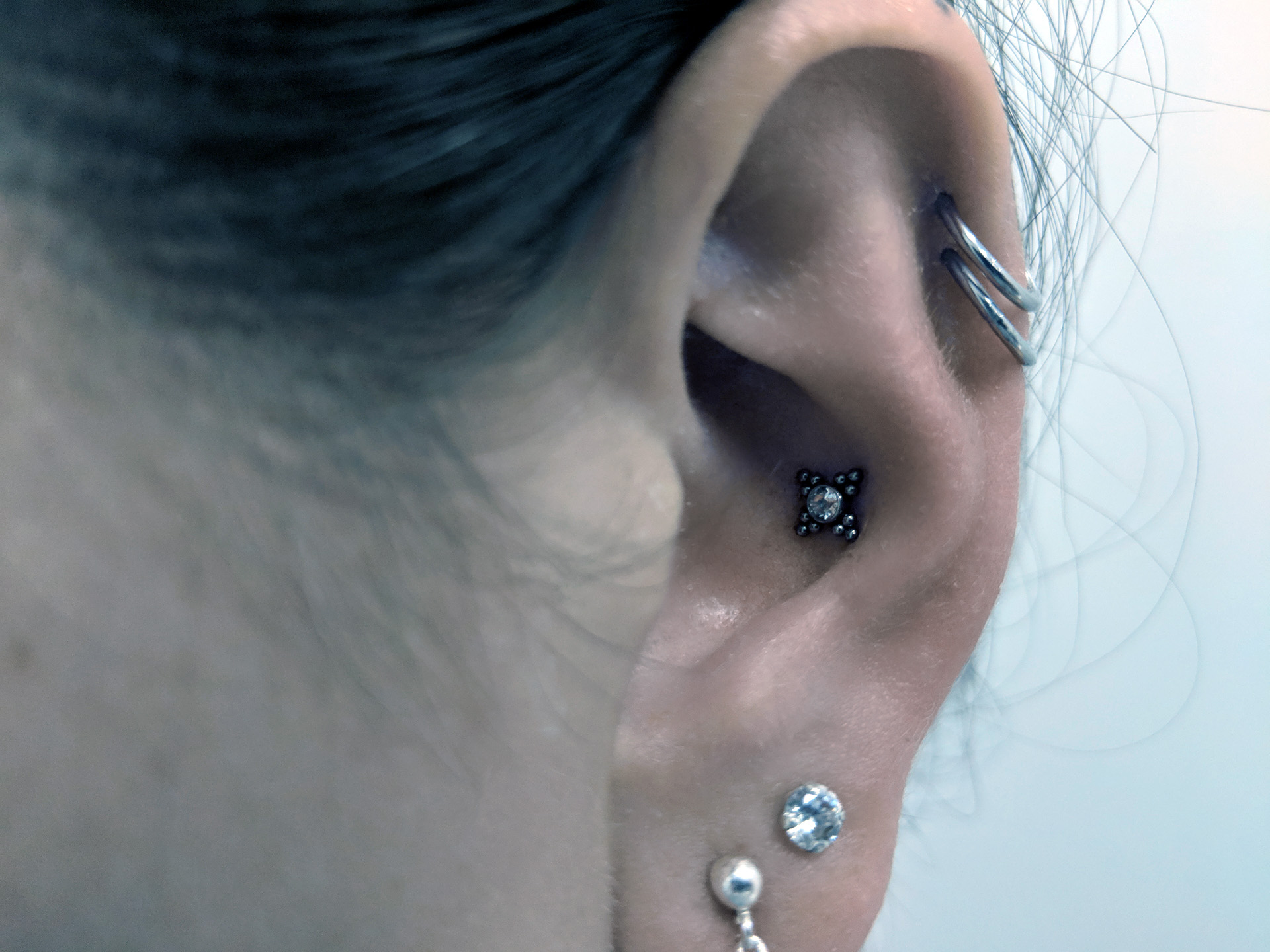 Double Helix Piercing with Conch Piercing
