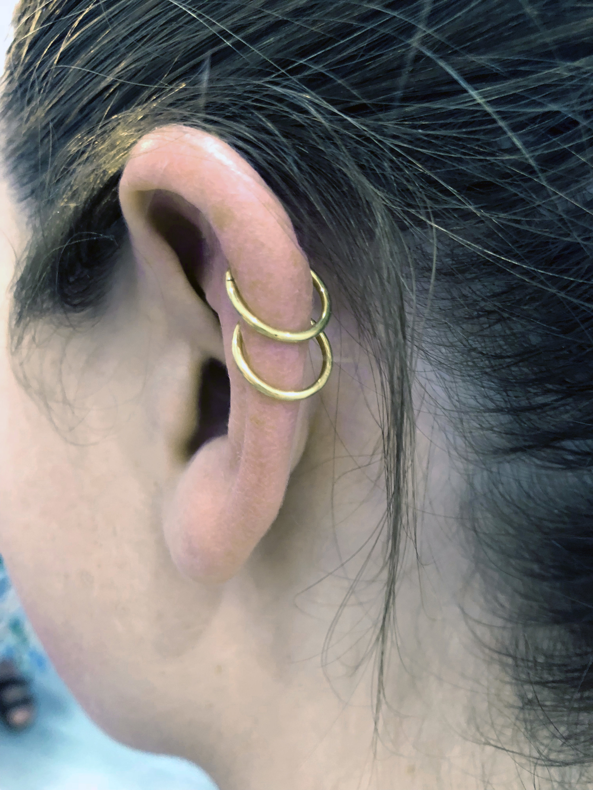 Classic Helix piercing with double gold rings