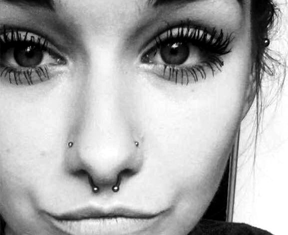 Lovely horseshoe septum jewellery with double nose piercing