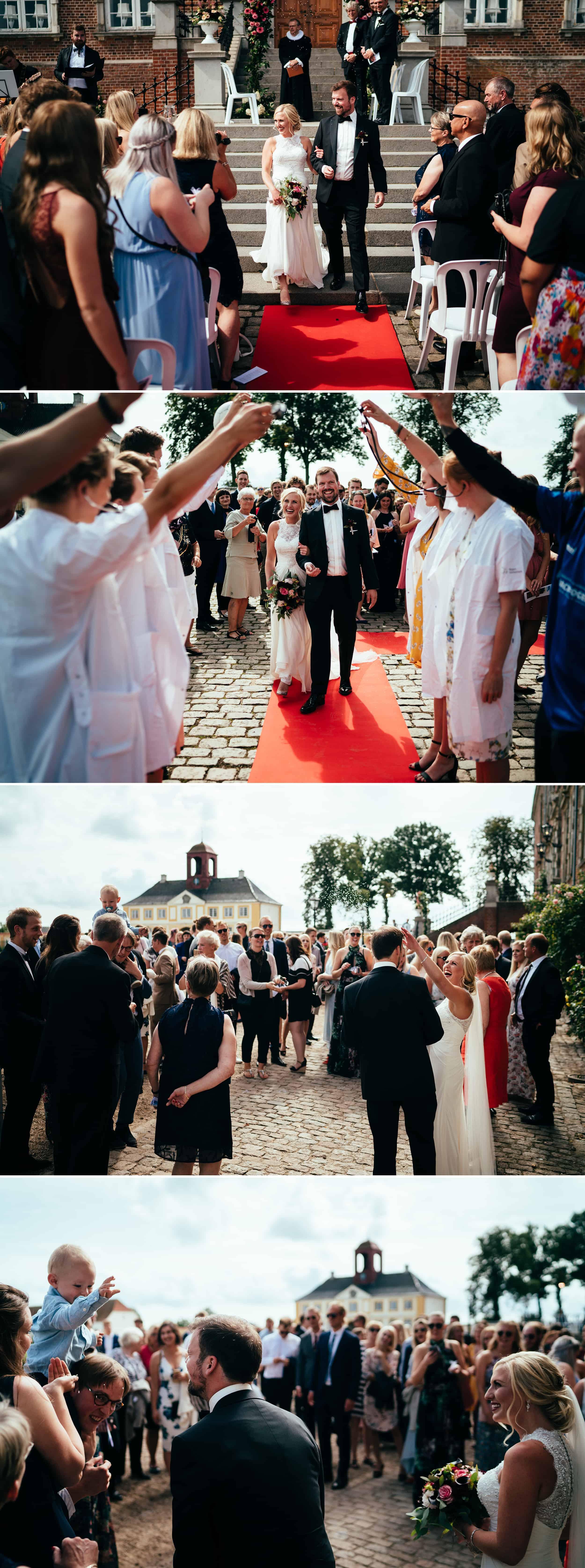 nygift-brudepar-går-gennem-række-af-gæster.jpg