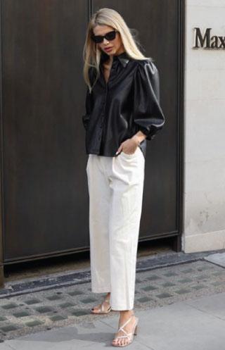 Blogger @kiraatikova wearing a Zara imitation leather shirt.