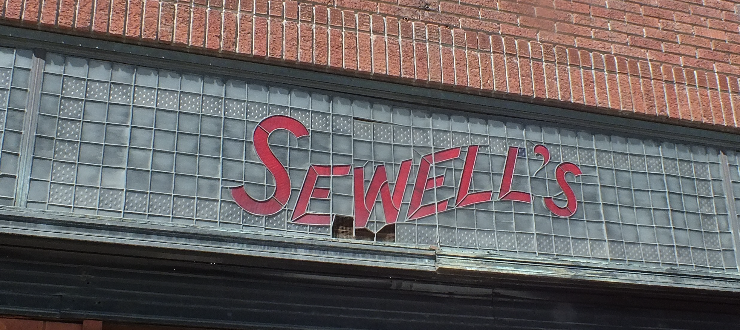 The Sewell's sign at 221 East Park Street before being removed for restoration.