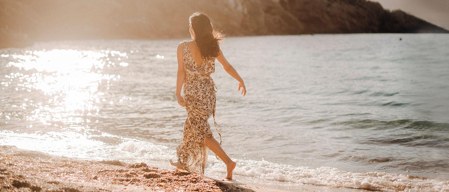 Harmonic_ Escapes_ Ibiza_Founder_Cynthia_running_Benirras_beach_sunset