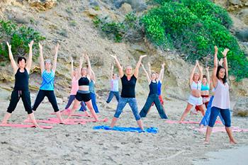 Harmonic_Escapes_Ibiza_Yoga_retreat_group_beach_yoga_sunrise
