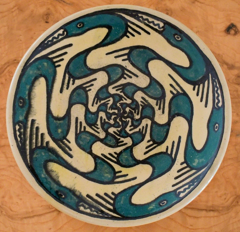 A Rare Shearwater Pottery Plate, c. 1930-40, decorated by Walter Inglis Anderson (1903-1965) with stylized figures of great blue herons in teal blue and black slip, impressed dime size mark, diam. 8 1/2 in.