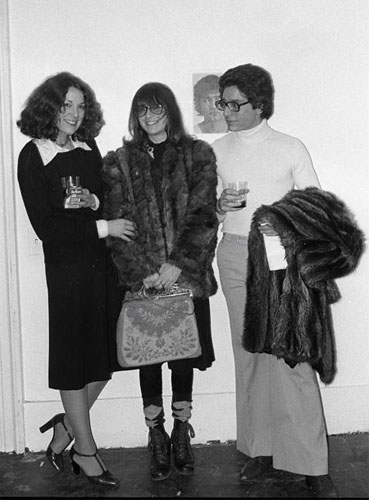 "Artist Marcia Resnick (center) with Susan Penzner, curator of Self Portraits, and Jeffrey Deitch, curator of ""Lives"" at the opening of Self-Portraits, Fine Arts Building, 1975. Photo by Marcia Resnick"