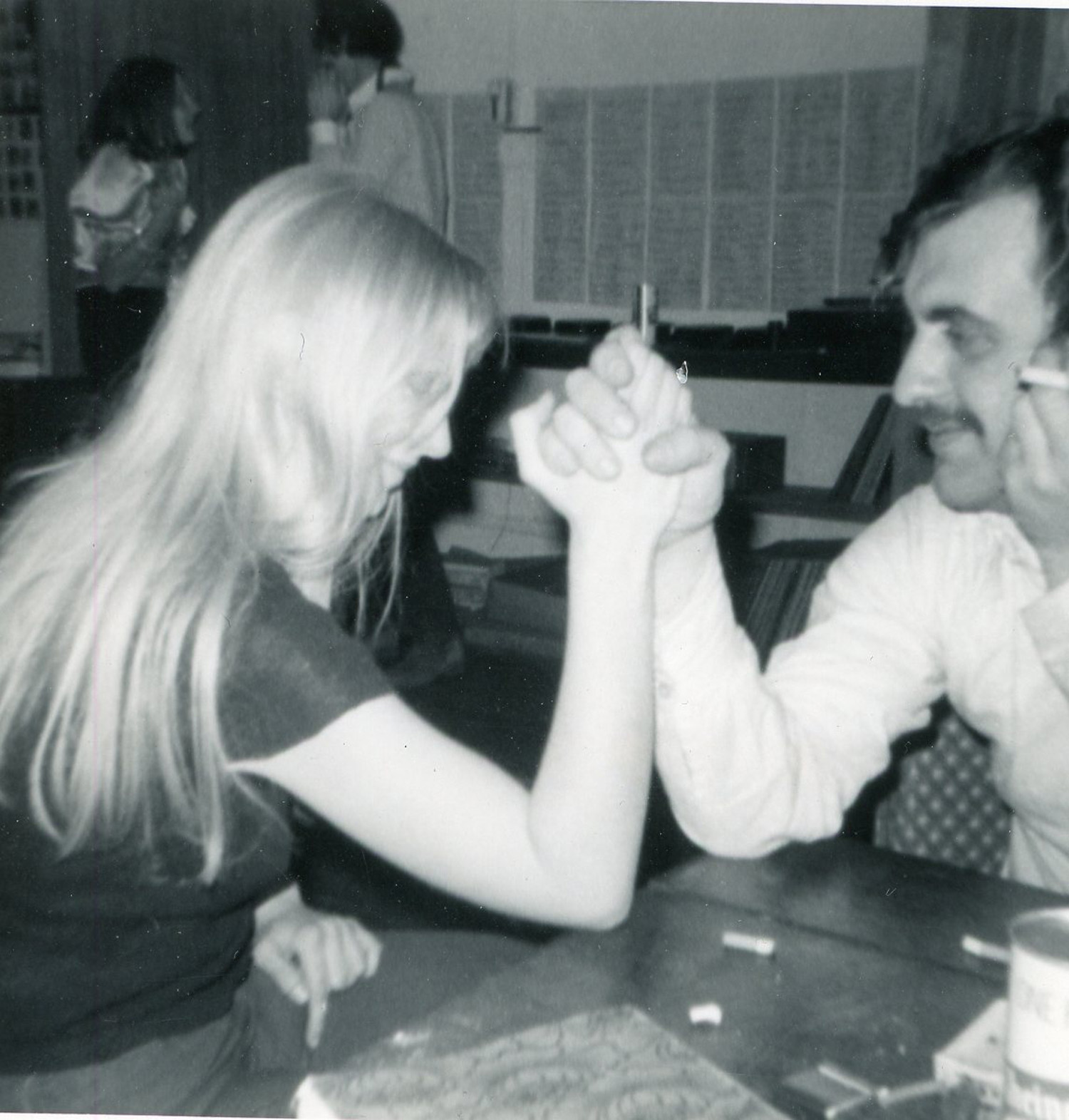 Janet Tate and Mike arm wresting, c. 1971.