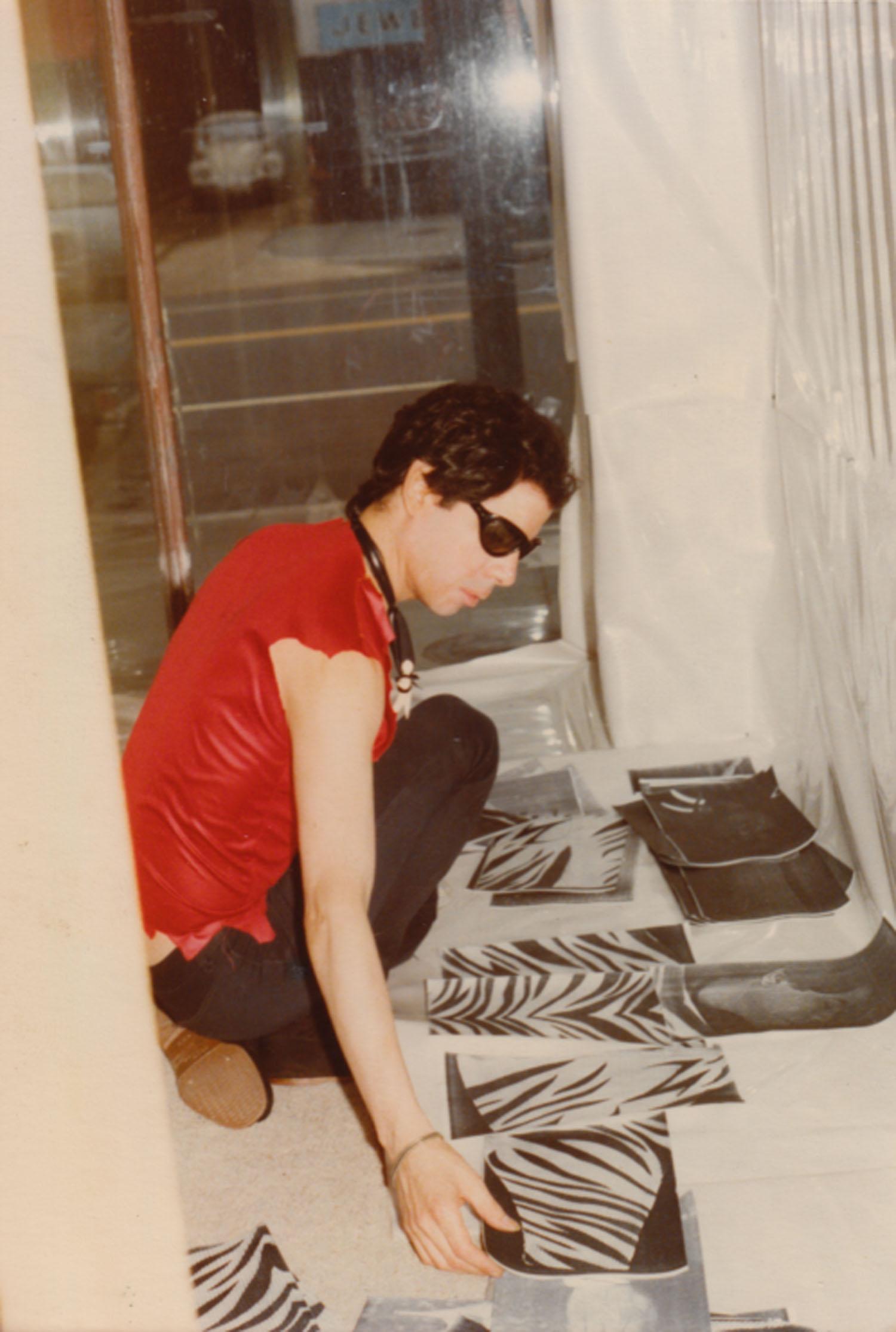 Daimon working on the window installation at the Punk Art Exhibition, Washington DC, 1978