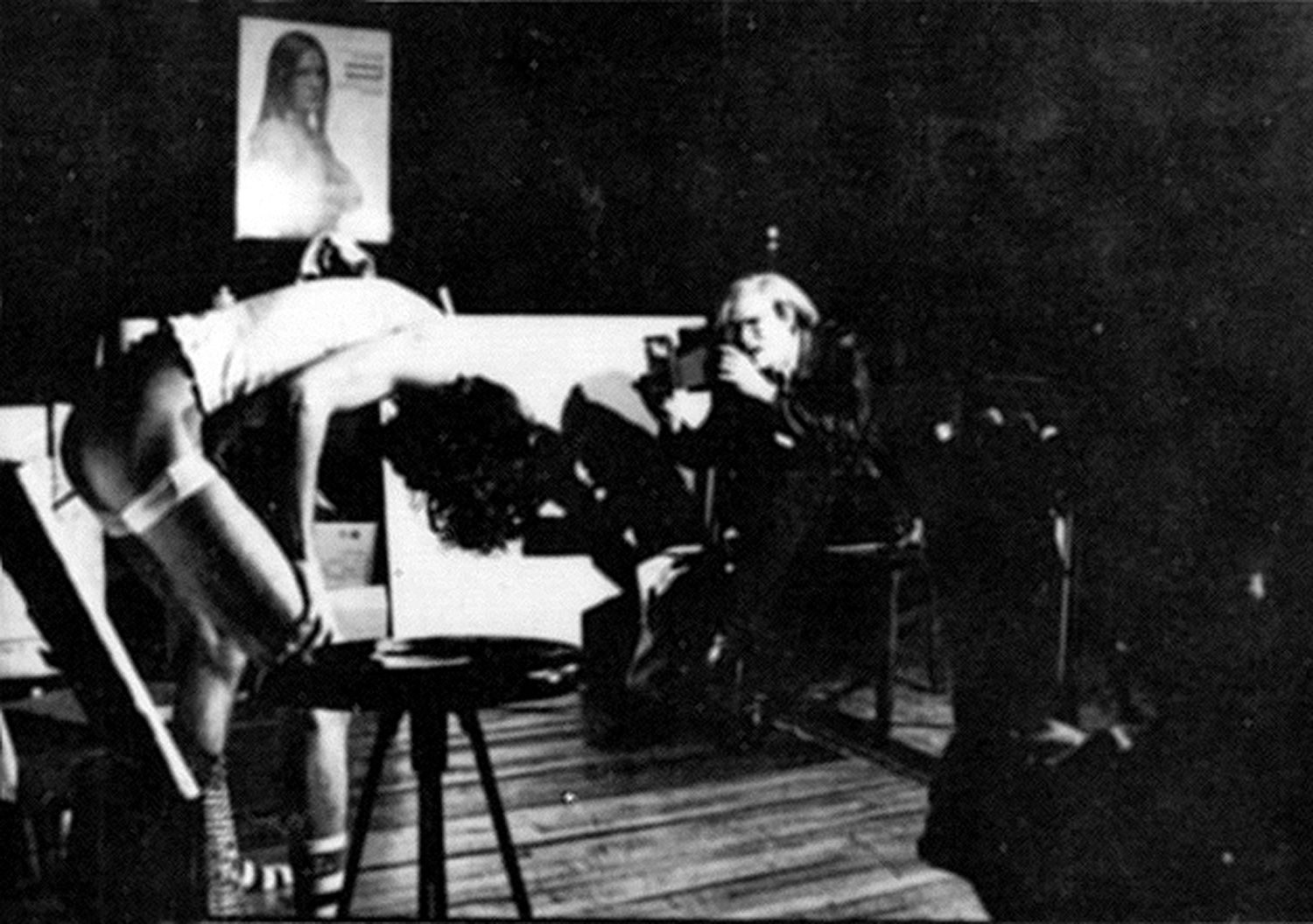 """Neke Carson painting his """"rectal realist"""" portrait of Andy Warhol, 1972. Photo by Anton Perich"""