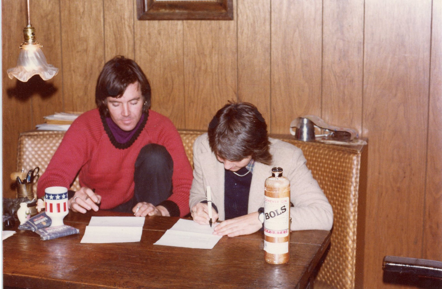 Bettie and her bother-in-law, Peter, signing the purchase agreement for the houseboat in Amsterdam, 1979.