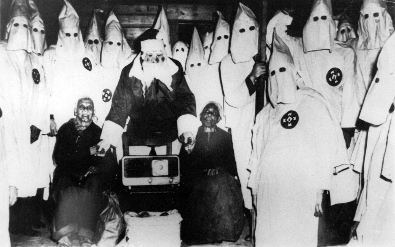 Klansmen and Santa Claus presented a radio to Jack Riddle & wife, Talladega, AL., 1948
