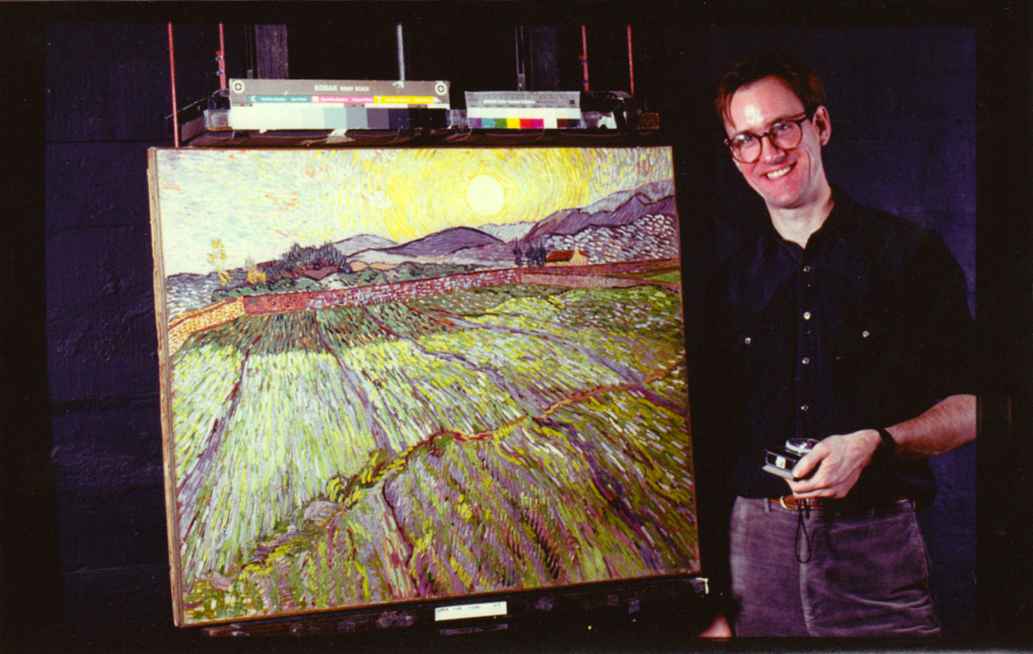 """Tom Warren, Vincent Van Gogh's painting """"Landscape with Rising Sun"""" at Sotheby's Auction House, 1985"""