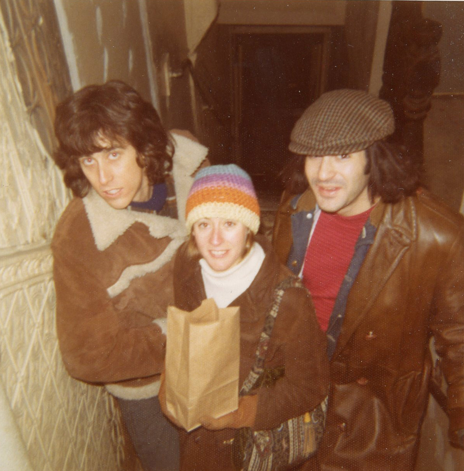 Mike Malloy, Susan and Marc on the steps at 98 Bowery, c. 1972