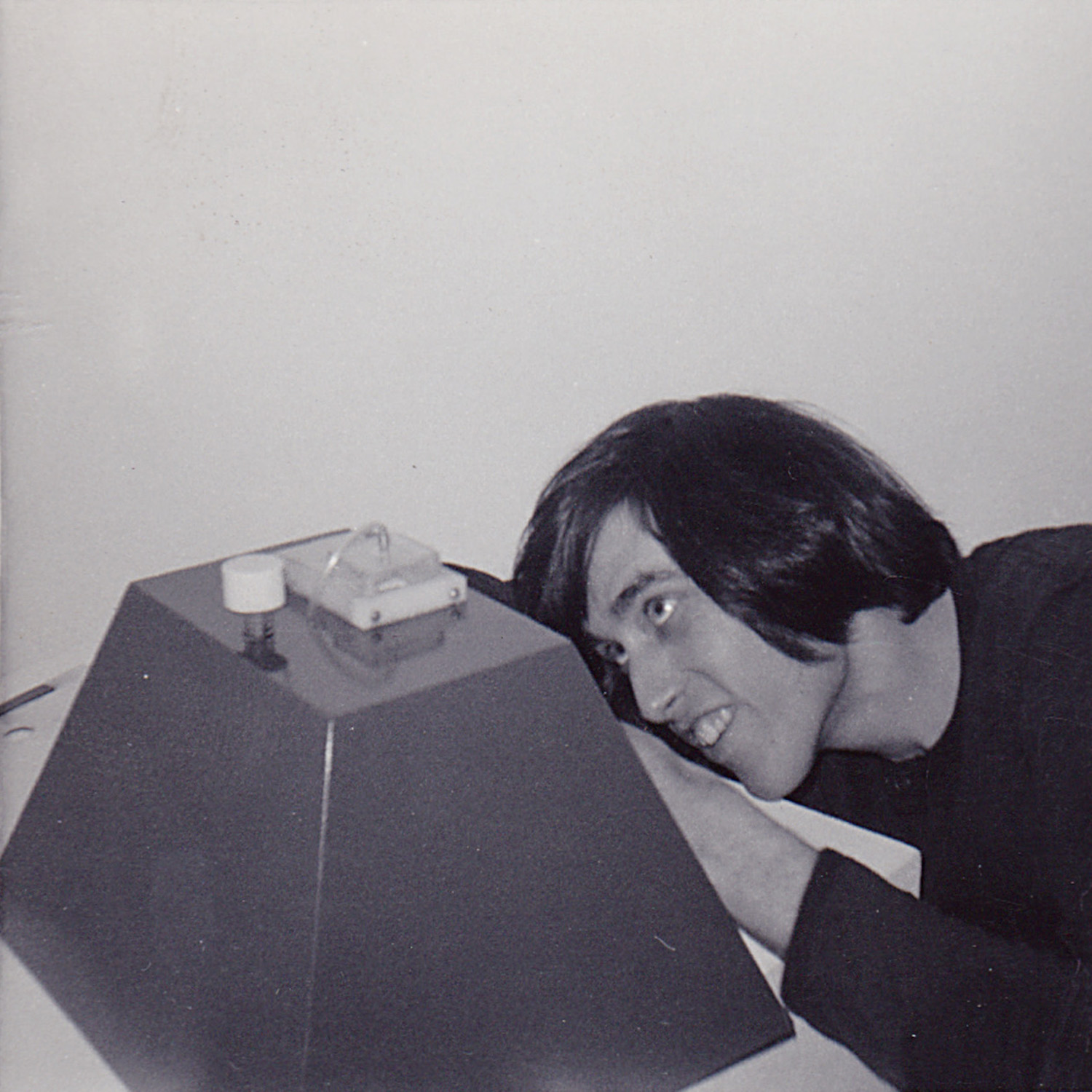 Artist Mike Malloy fixing his Ant Killing Machine at OK Harris Gallery, c. 1972