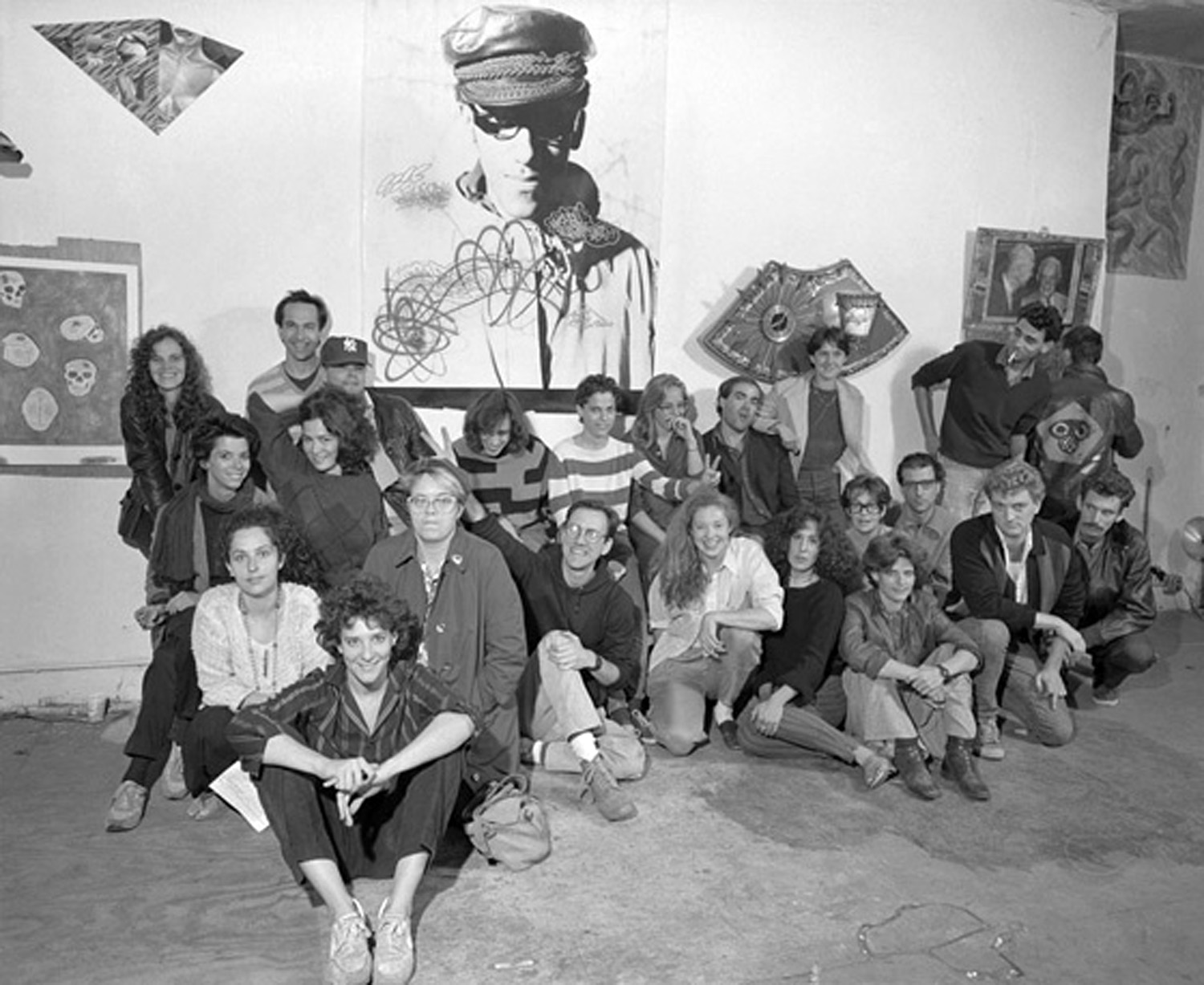 COLAB AT ABC NO RIO CIRCA 1984  (front) Andrea Callard; (2nd row) Kiki Smith, Sally White, Tom Warren, Becky Howland, Jolie Stahl, Bebe Smith, Walter Robinson, Alan Moore; (3rd row -left) Julie Harrison, Ellen Cooper; (3rd row –right) Maria Sutcliffe, Matthew Geller, Jim Sutliffe (standing), Bobby G (back to the camera); (back row) Jody Culkin, Brian Piersol, Joseph Nechvatal, Cara Brownell, Cara Perlman, Brigitte Engler, Doug Mulaire, Mindy Stevenson. Photo by Peter Sumner Walton Bellamy