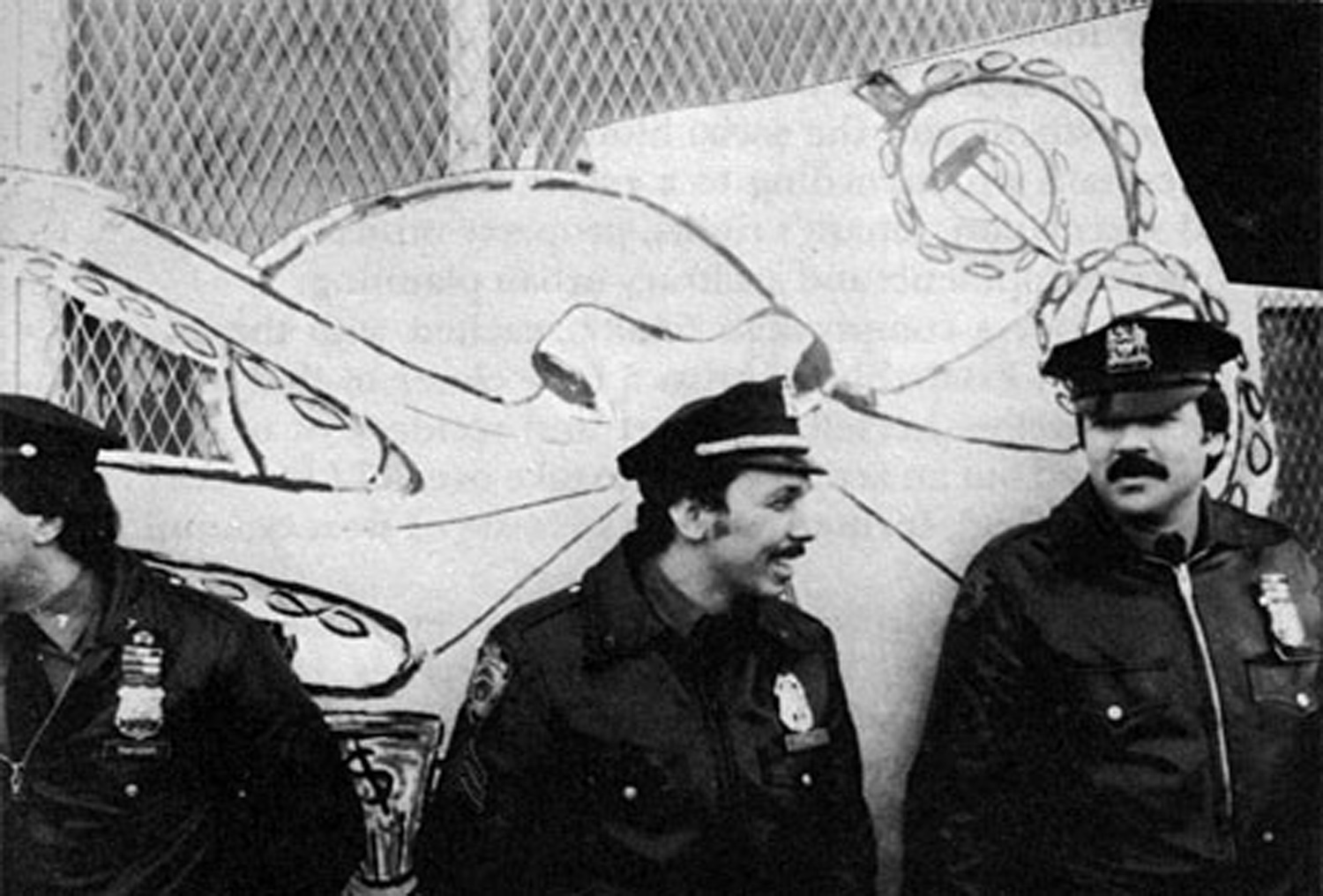 "Scene outside the ""Real Estate Show"" with police guarding city workers nailing the doors shut following the eviction of the artists, 1980. Octopus Mural by Becky Howland, Photo by Lawrence Lehmann."