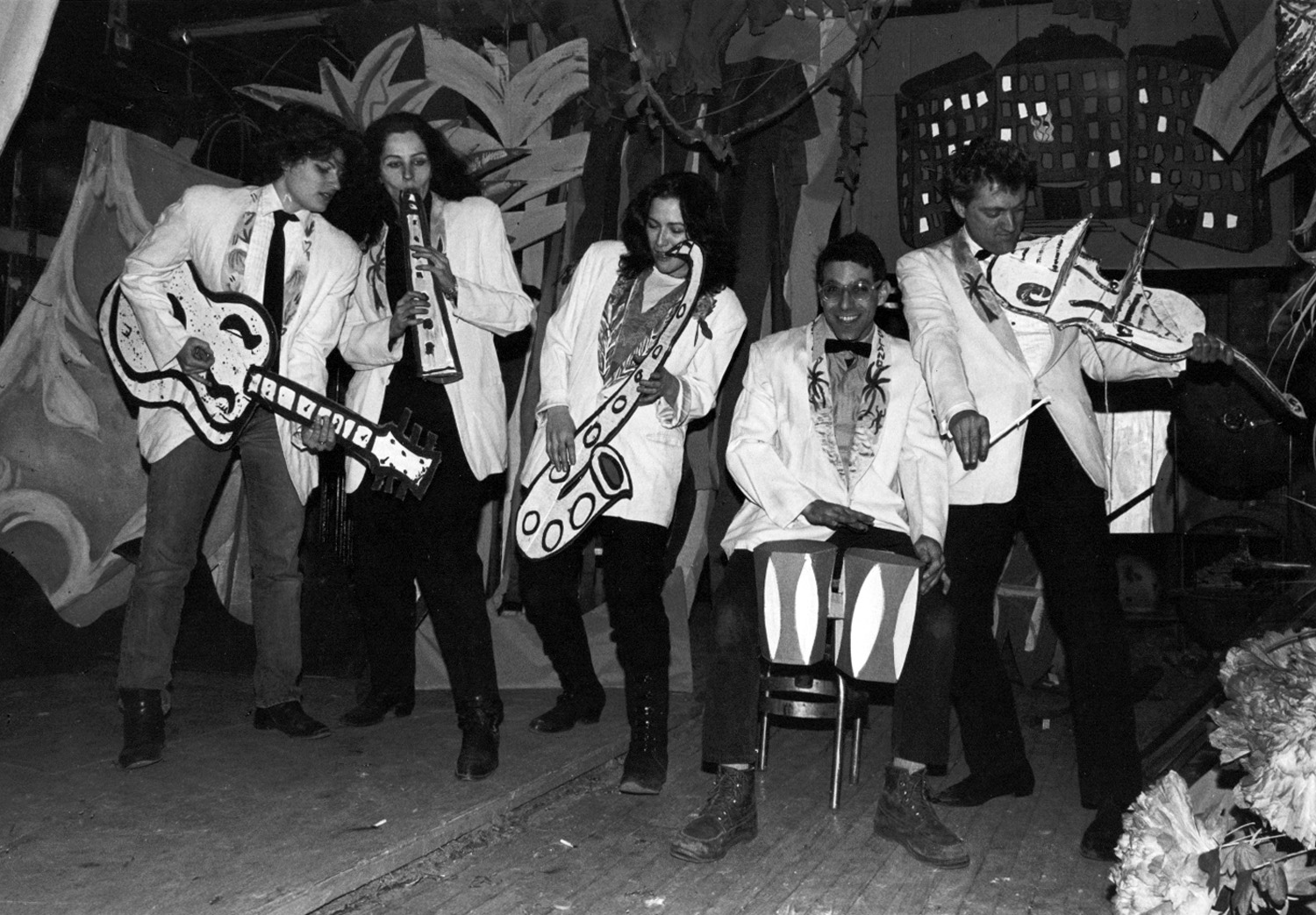 ABC No Rio's Cardboard Band performing at The Isle of Negative Utopia show at The Kitchen, 1983. (left to right) Bebe Smith, Kiki Smith, Ellen Cooper, Bobby G, and Walter Robinson. Photo by Christy Rupp